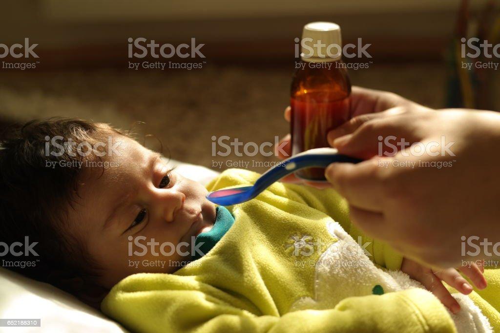 Newborn baby gets medicine stock photo