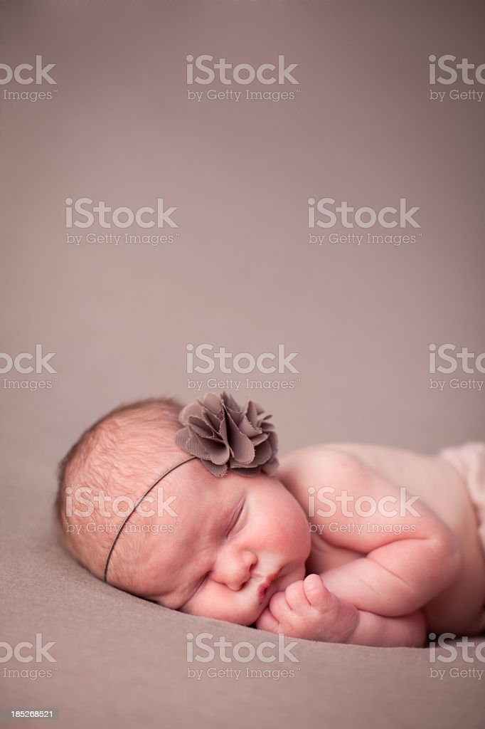 Newborn Baby Girl Cuddled in Fetal Position, With Copy Space stock photo