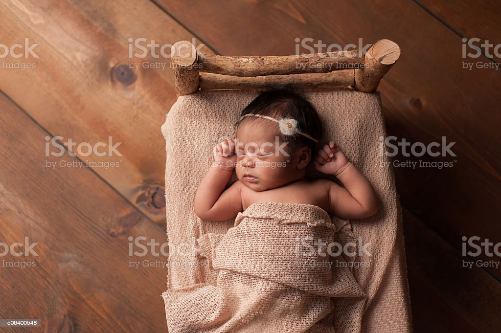 Newborn Baby Girl Sleeping in Tiny Bed stock photo