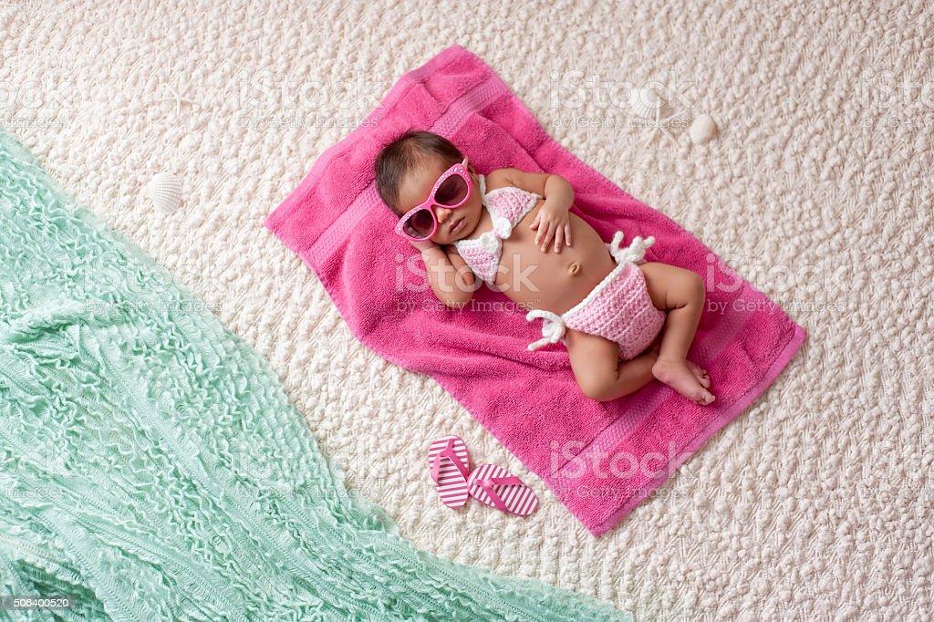 Newborn Baby Girl Wearing a Bikini and Sunglasses stock photo