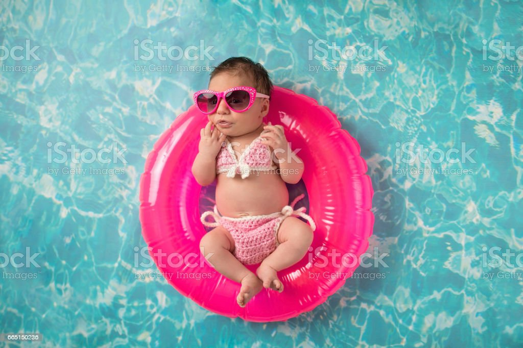 Newborn Baby Girl Wearing a Bikini and Sunglasses stock photo