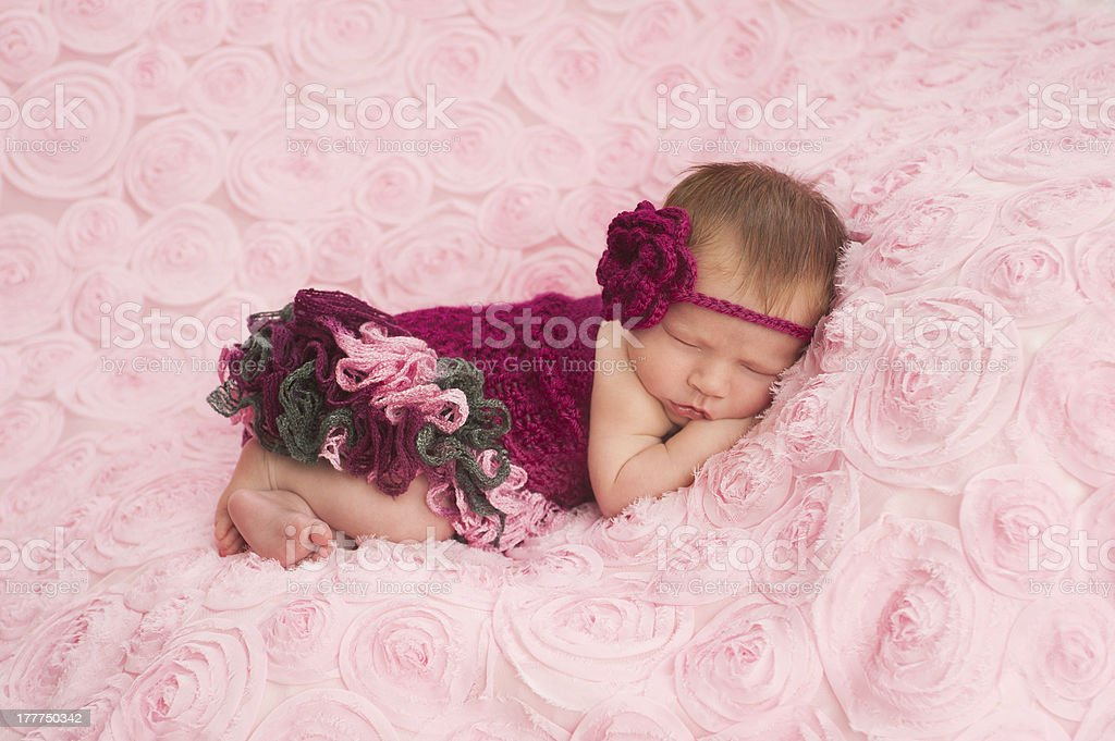 Newborn Baby Girl Wearing a Crocheted Romper royalty-free stock photo