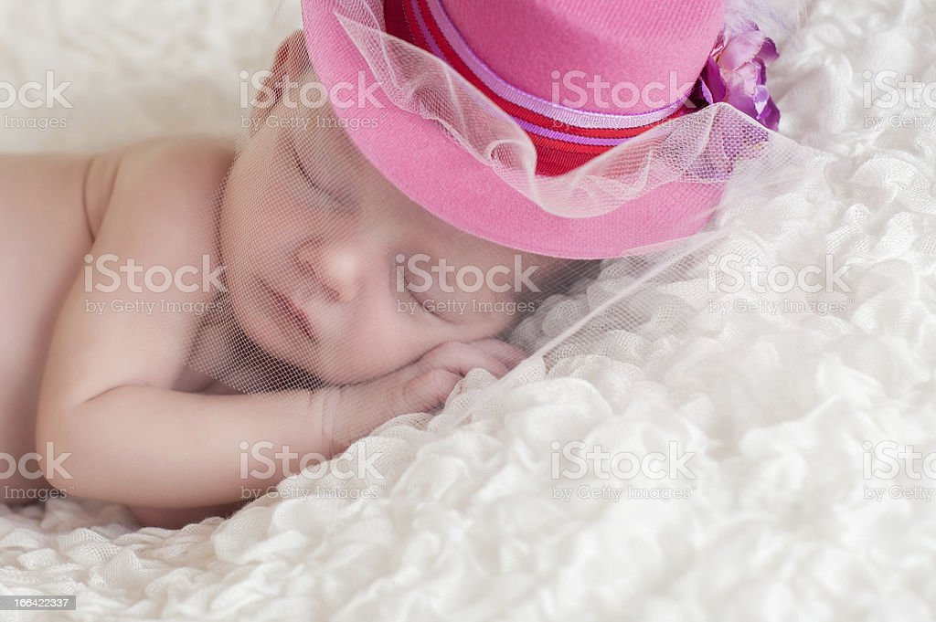 Newborn Baby Girl Wearing a Fancy Pink Hat royalty-free stock photo