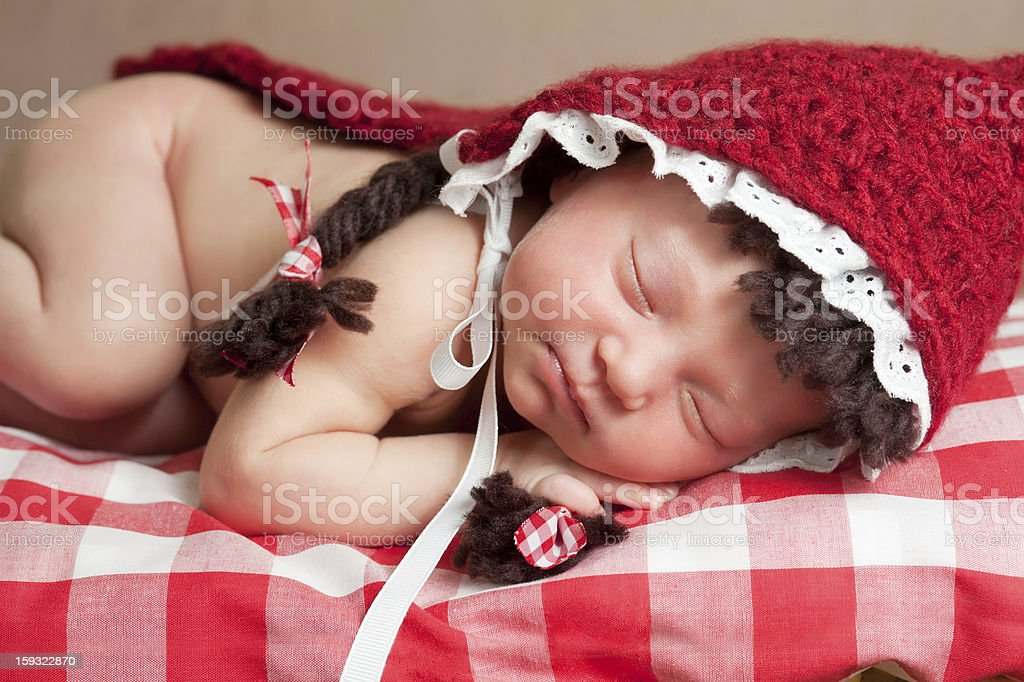 Newborn Baby Girl Wearing a Little Red Riding Hood Costume royalty-free stock photo