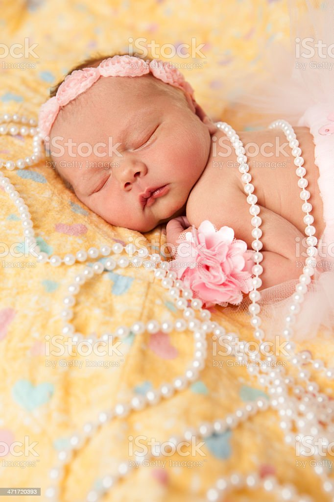 Newborn Baby Girl Wearing Pink Headband and Pearls stock photo