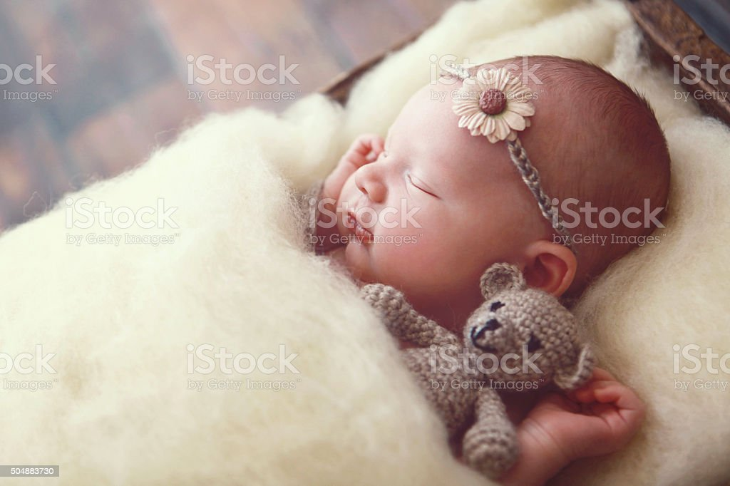 Newborn Baby Girl with Teddy Bear stock photo