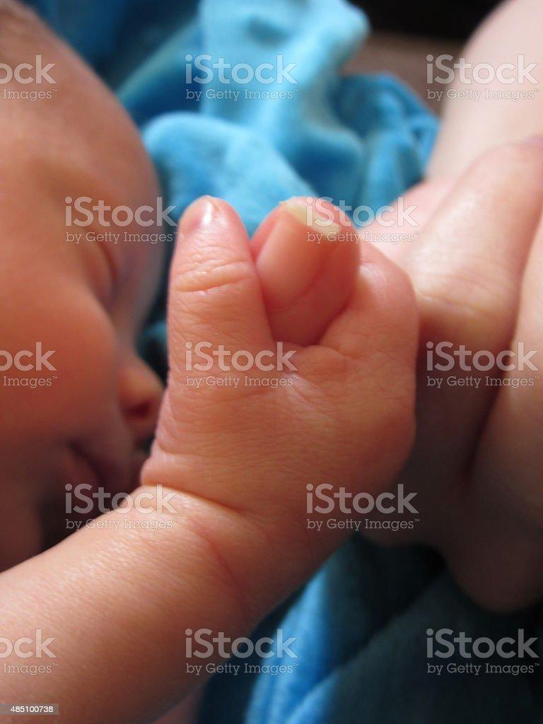 Newborn Baby Gripping Little Finger, Vertical stock photo