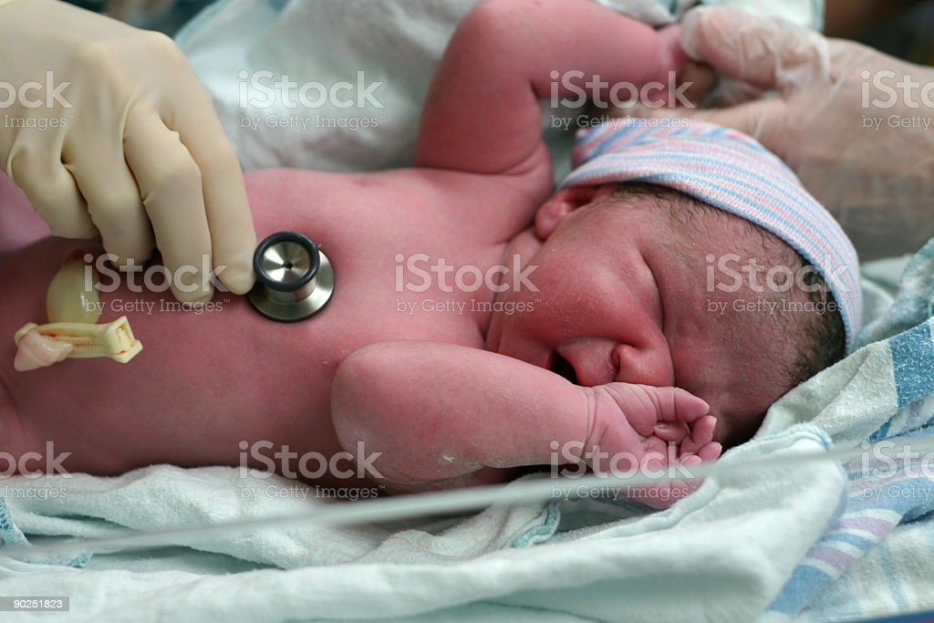 Newborn baby in hospital crying stock photo