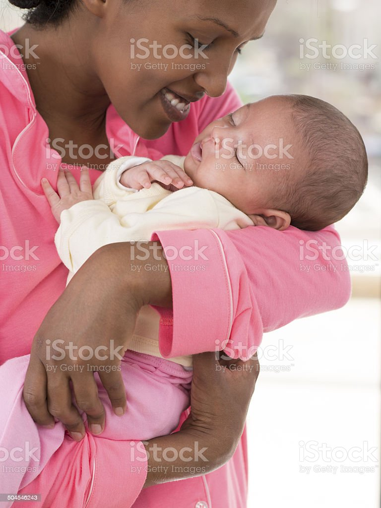 Newborn baby in mother's arms. stock photo