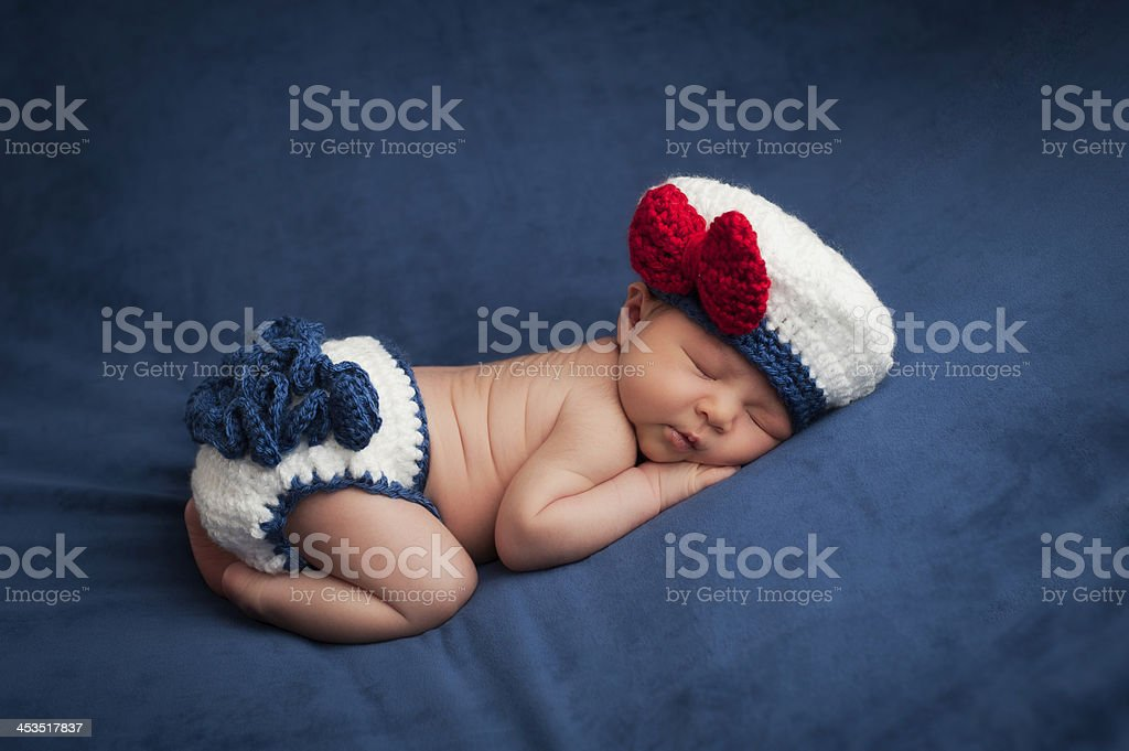 Newborn Baby in Sailor Girl Costume stock photo