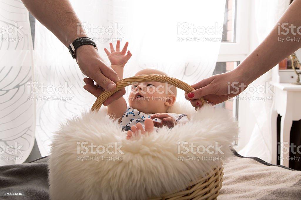 newborn baby in the basket stock photo