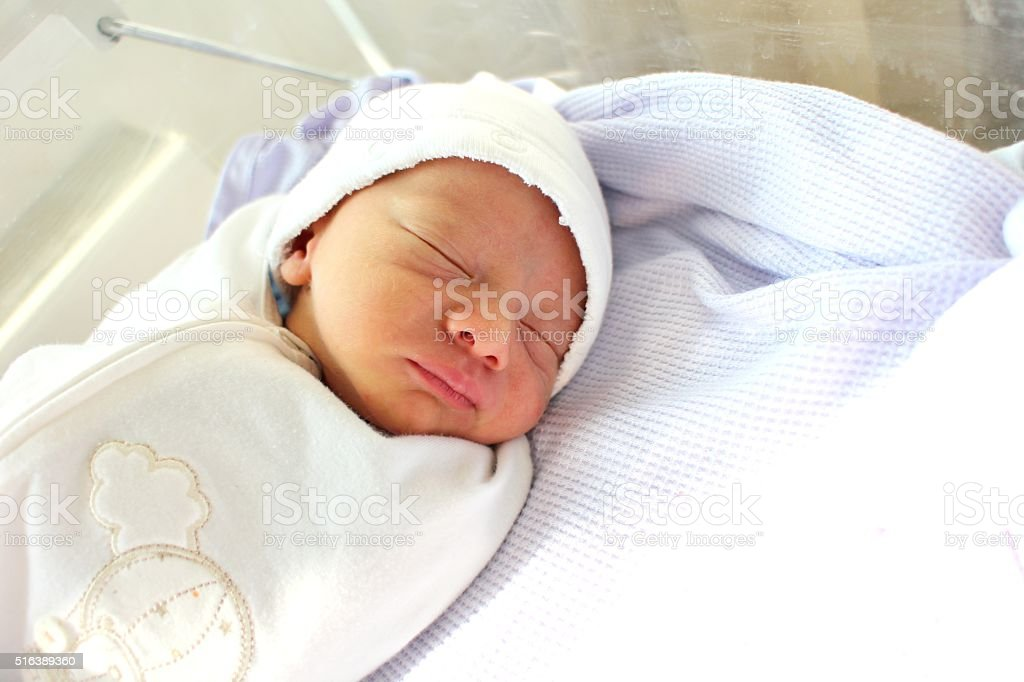 Newborn baby in the hospital stock photo
