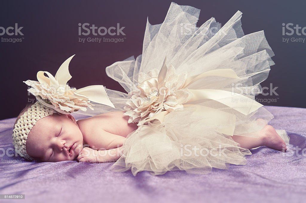 Newborn baby in tutu stock photo
