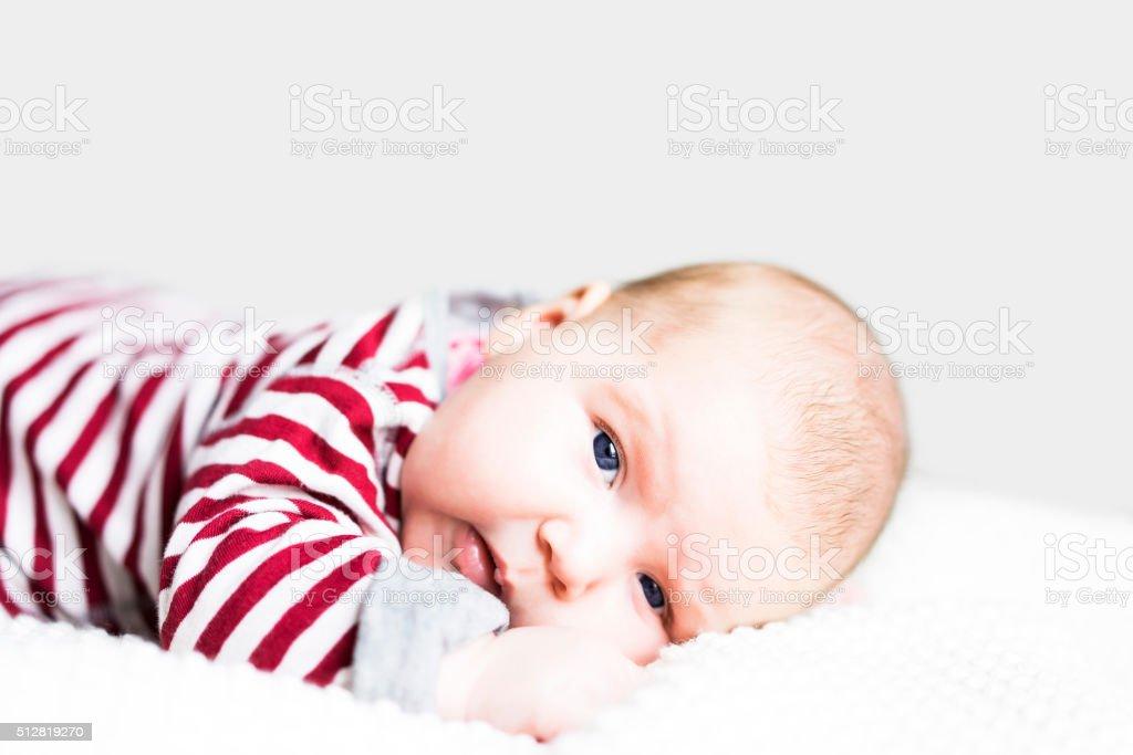 Newborn baby laying face down stock photo