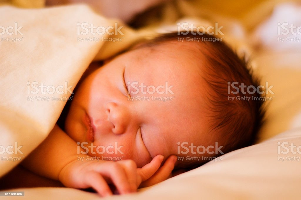 Newborn baby laying on the bed royalty-free stock photo