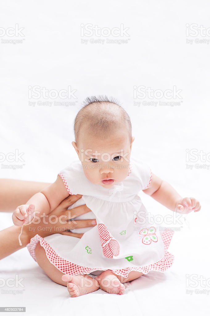 Newborn baby lying in bed, soft focus stock photo