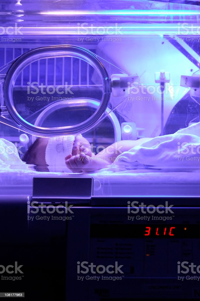 Newborn Baby Lying in Incubator stock photo