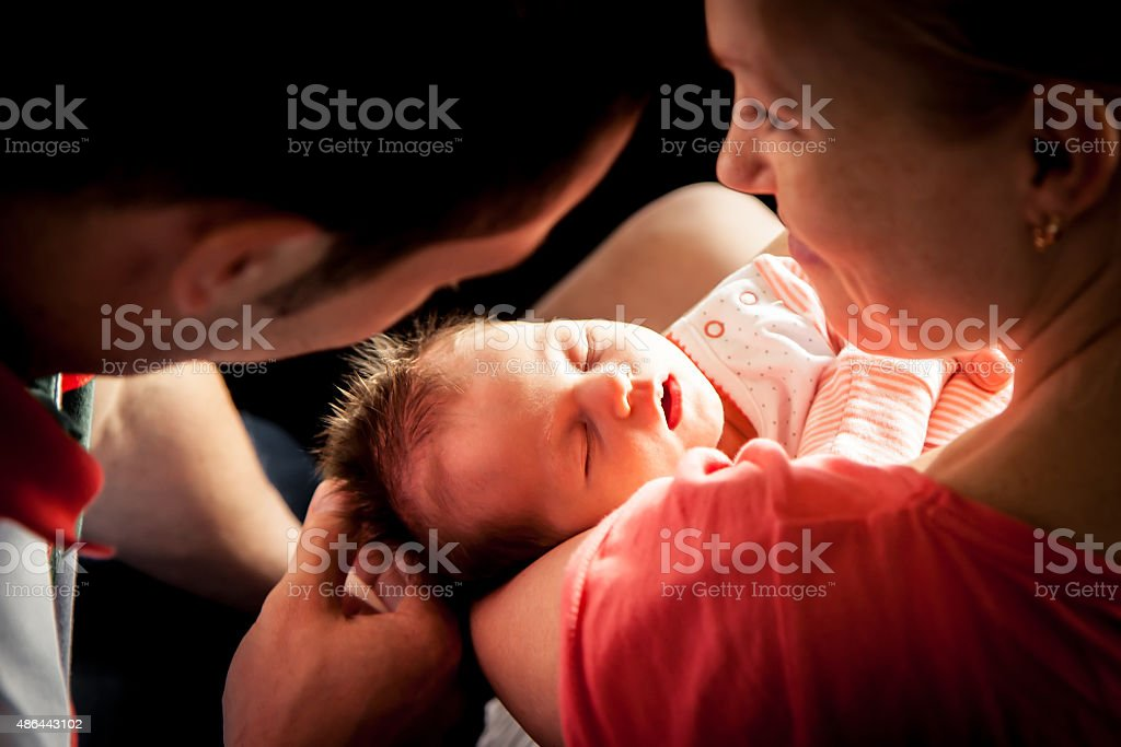 Newborn baby on mother hands stock photo