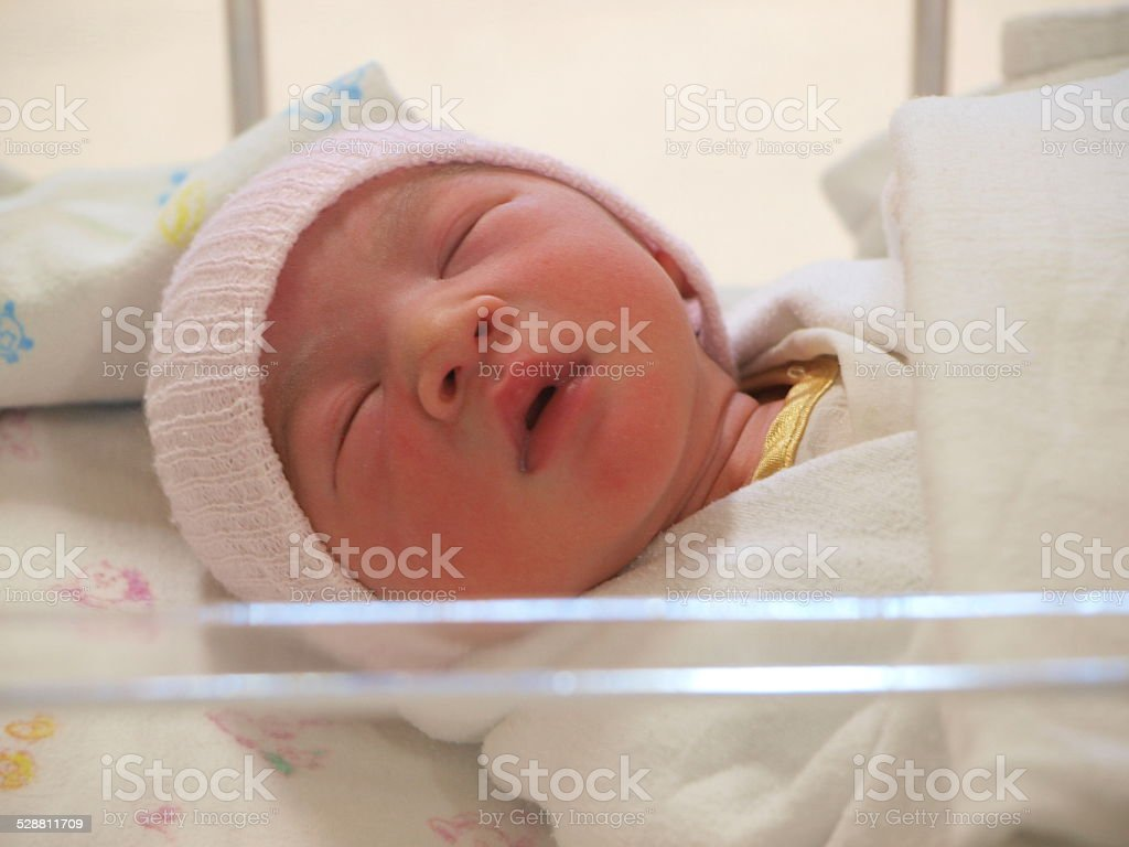 Newborn baby on the bed stock photo