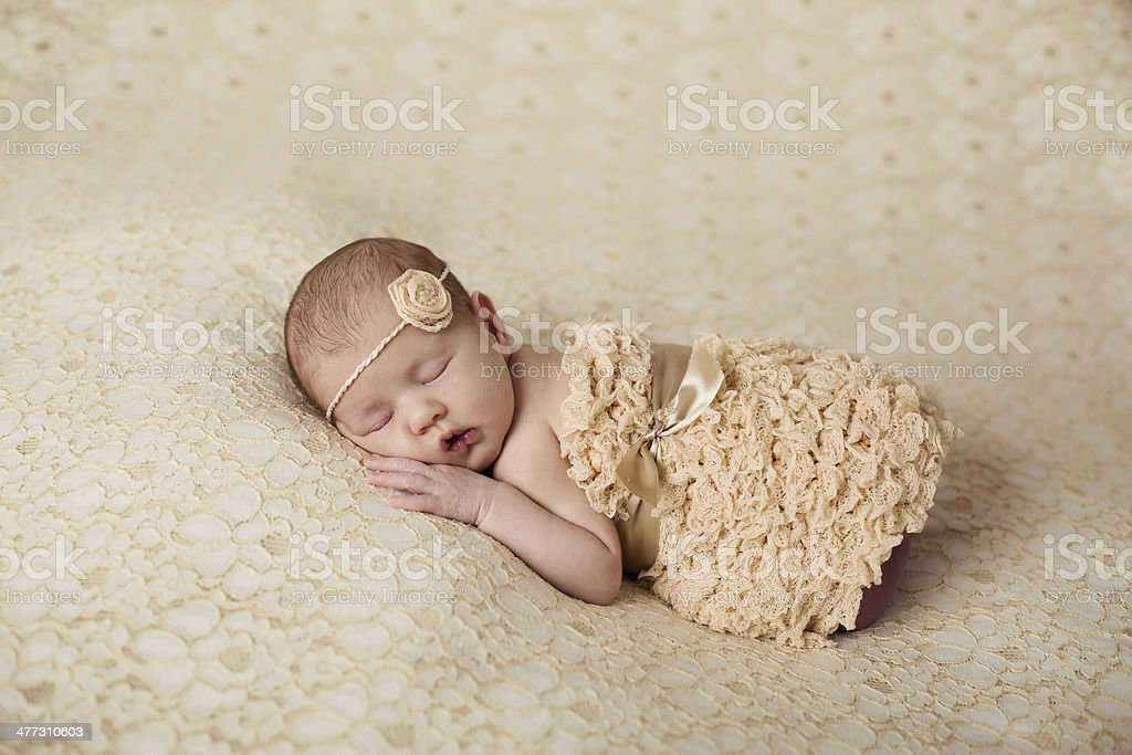 Newborn baby peacefully sleeping royalty-free stock photo