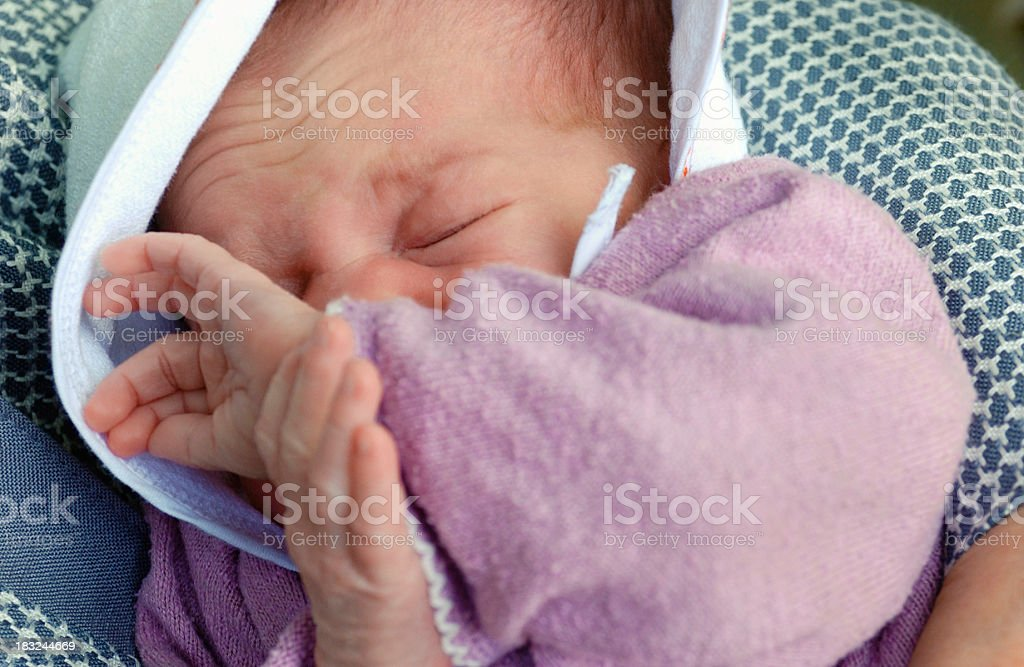 Newborn baby sleeping grimacing, from above royalty-free stock photo