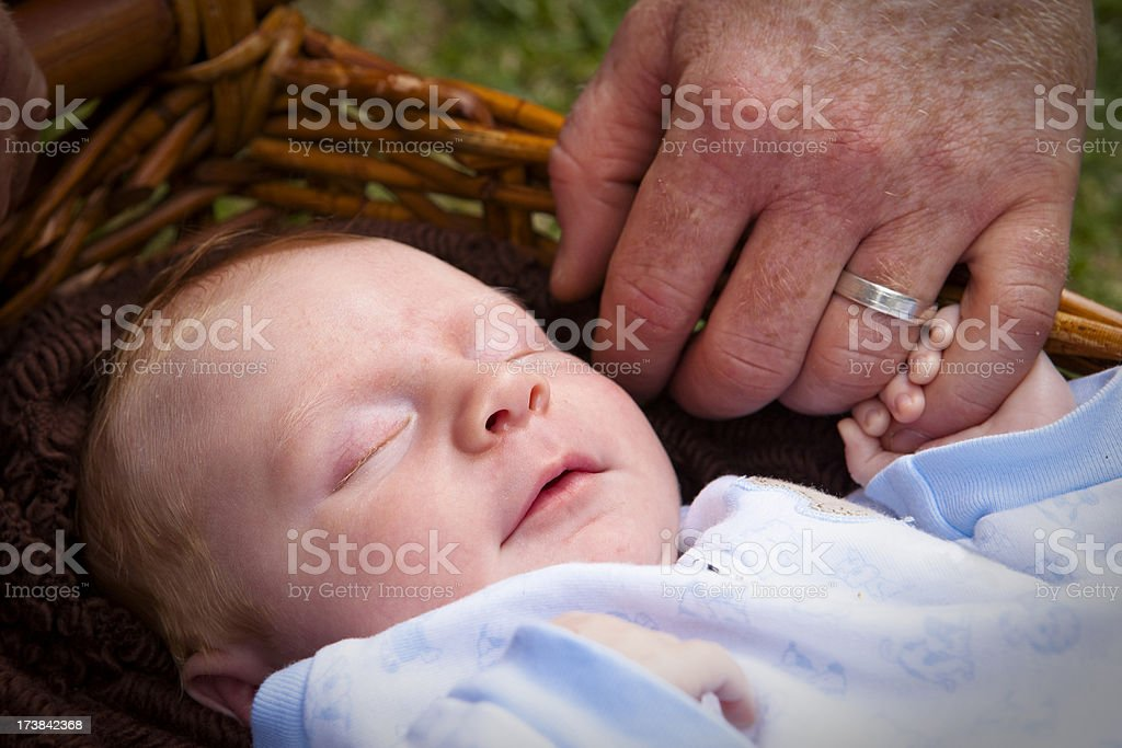 Newborn baby sleeping in basket. royalty-free stock photo