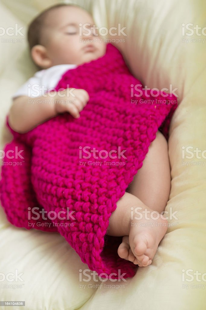 Newborn baby sleeping in bed royalty-free stock photo
