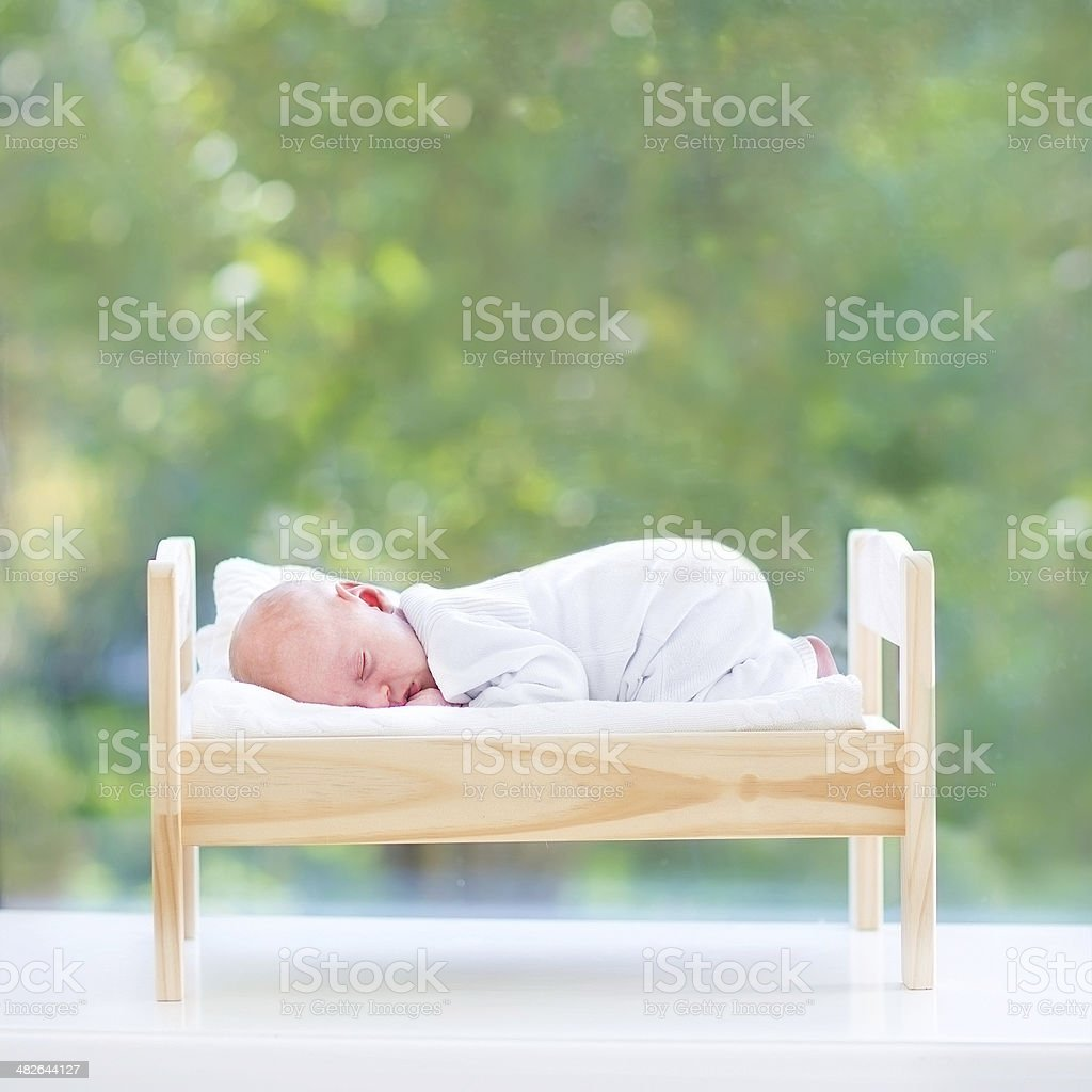 Baby bed next to bed - Newborn Baby Sleeping In Toy Bed Next To Big Window Royalty Free Stock Photo