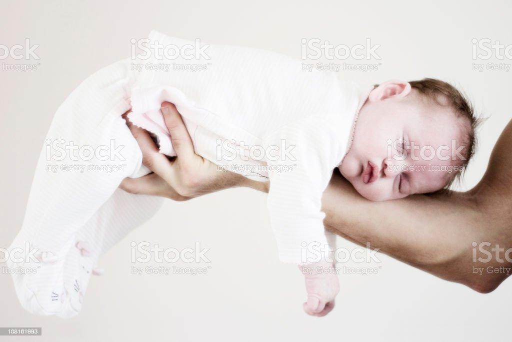 Newborn Baby Sleeping on Father's Arm royalty-free stock photo