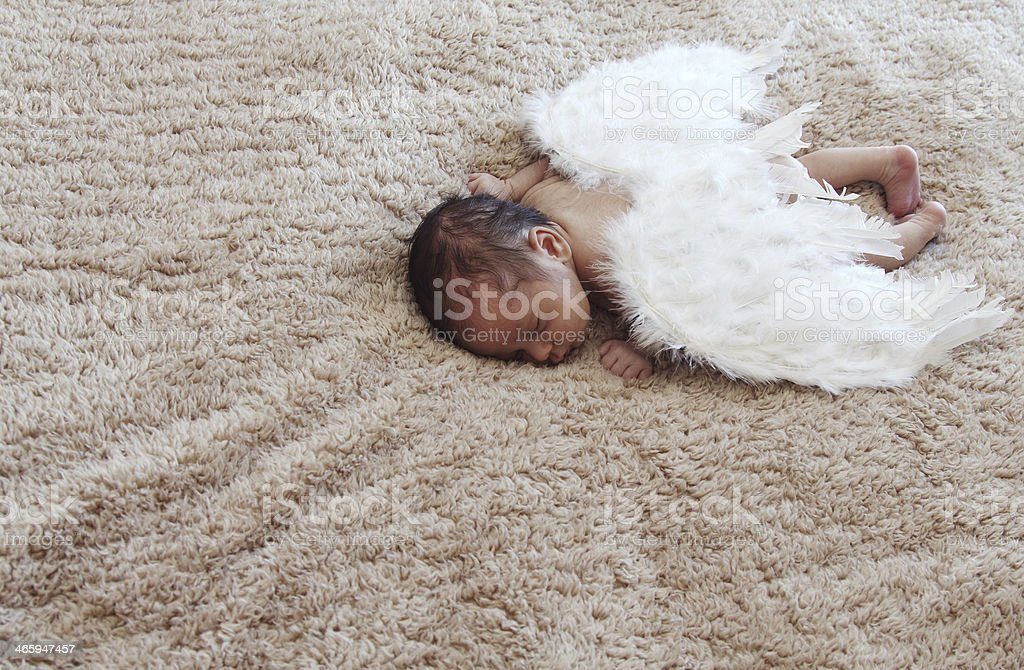 newborn baby sleeping with angel wings royalty-free stock photo