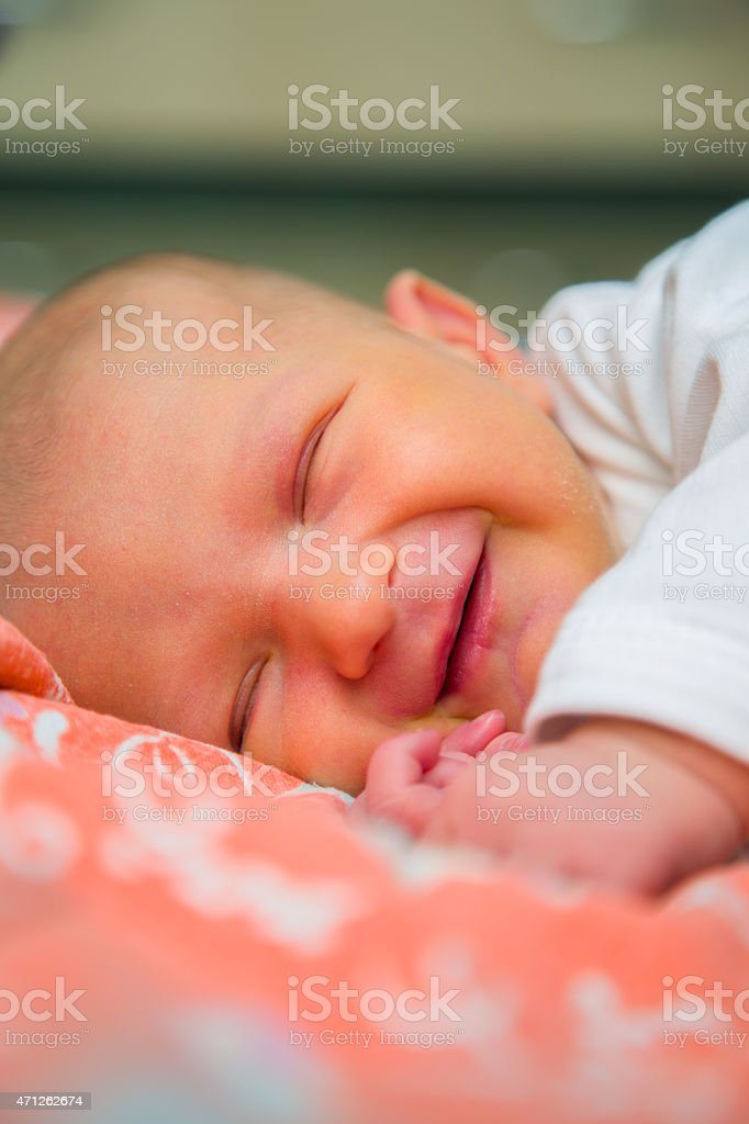 Newborn baby smiles stock photo