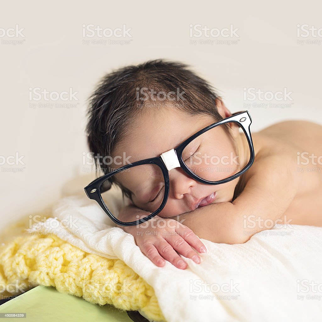 Newborn baby wearing glasses royalty-free stock photo