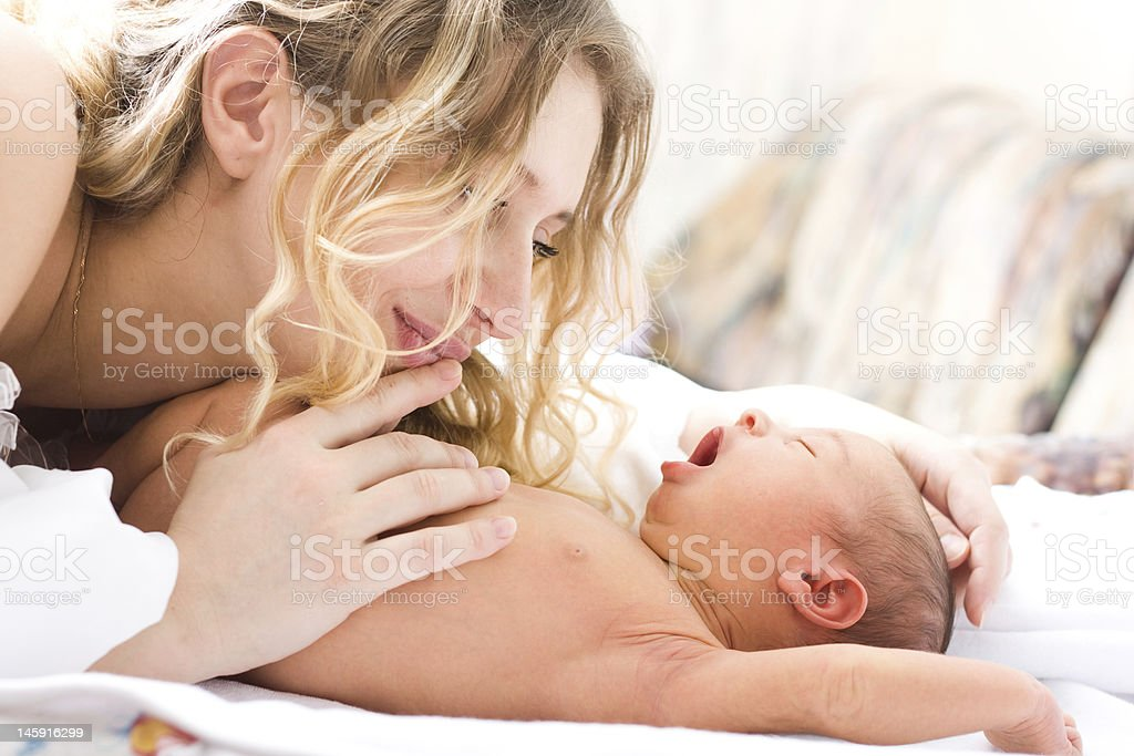 Newborn baby with mother royalty-free stock photo
