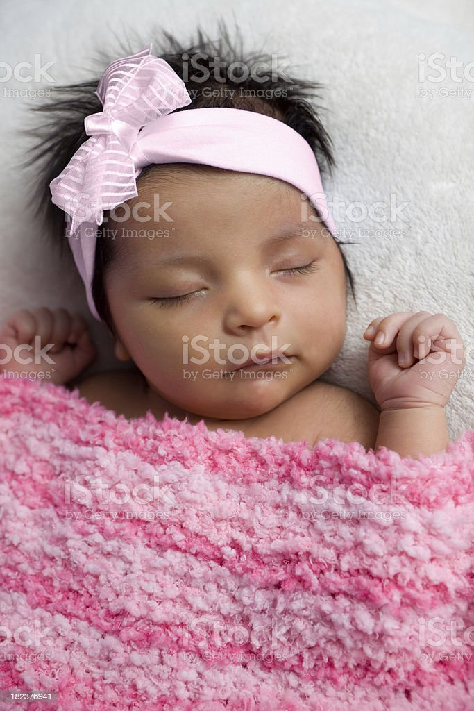 Newborn Baby with Pink Bow royalty-free stock photo
