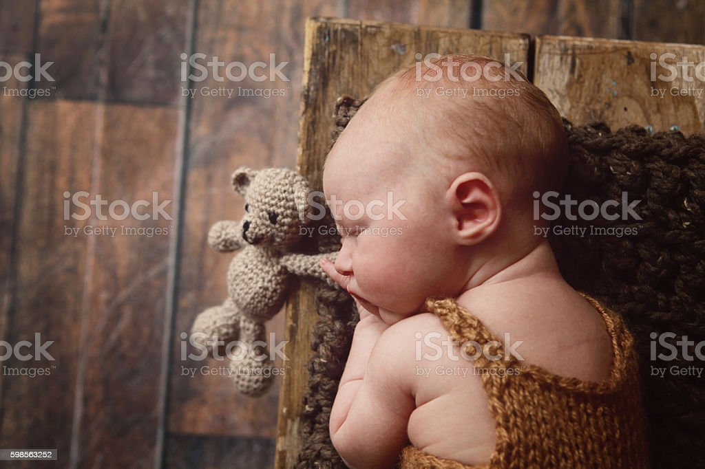 Newborn Baby with Teddy Bear stock photo