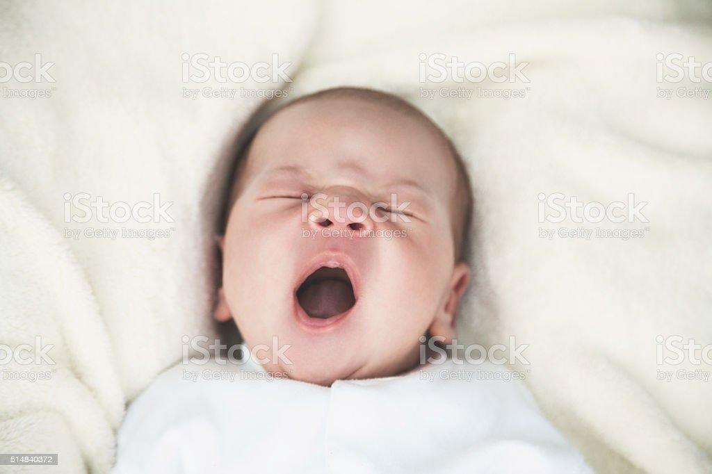 Newborn baby yawning stock photo