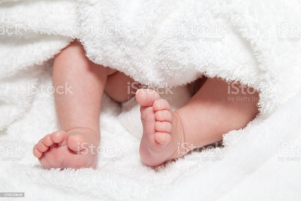 Newborn baby's feet and bottom end stock photo