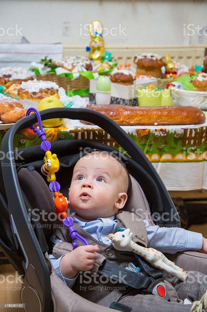 Newborn boy in a stroller stock photo