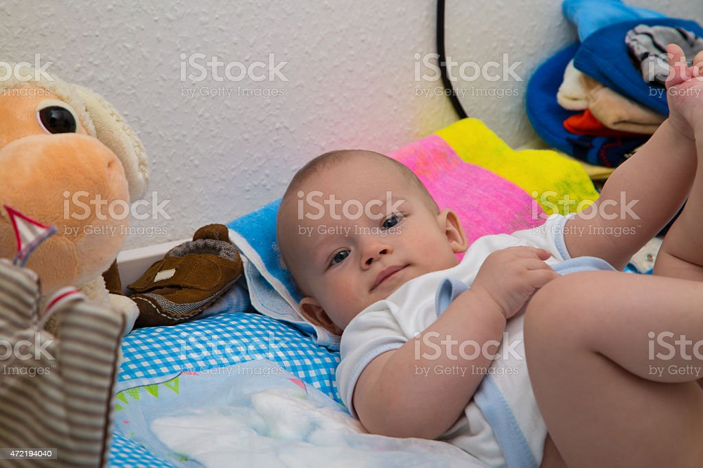 Newborn boy on the changing table stock photo