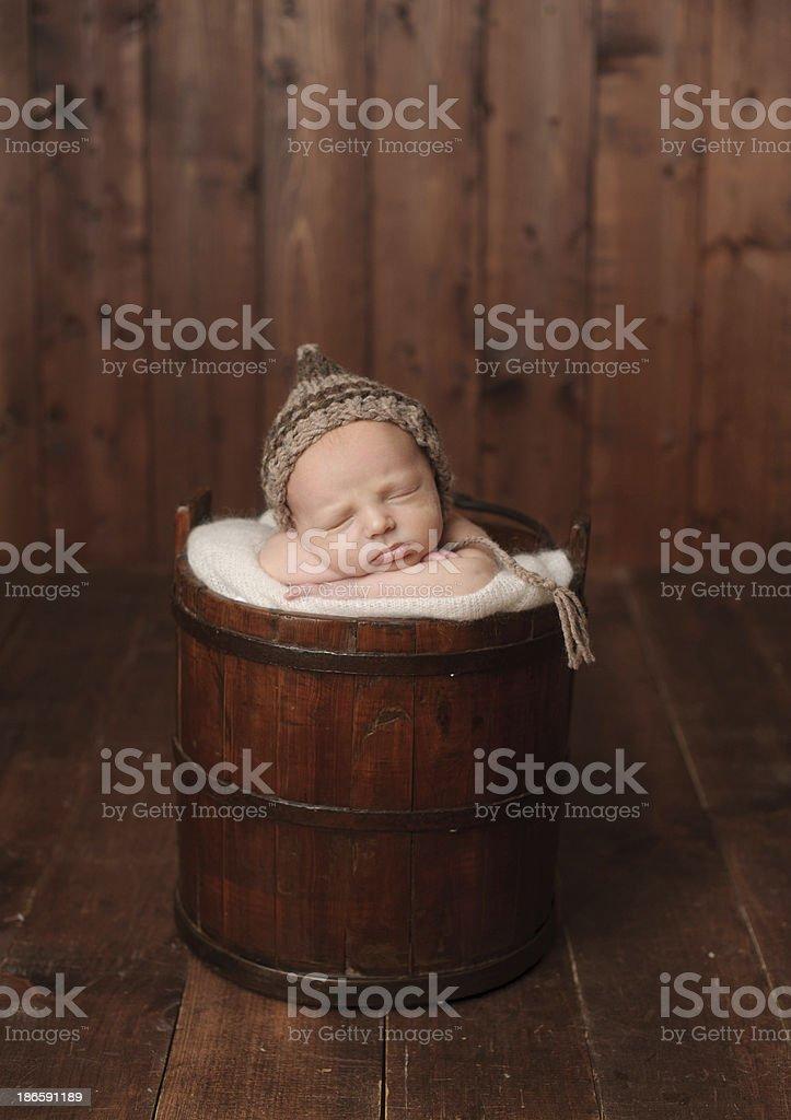 Newborn Boy Sleeping in Bucket royalty-free stock photo