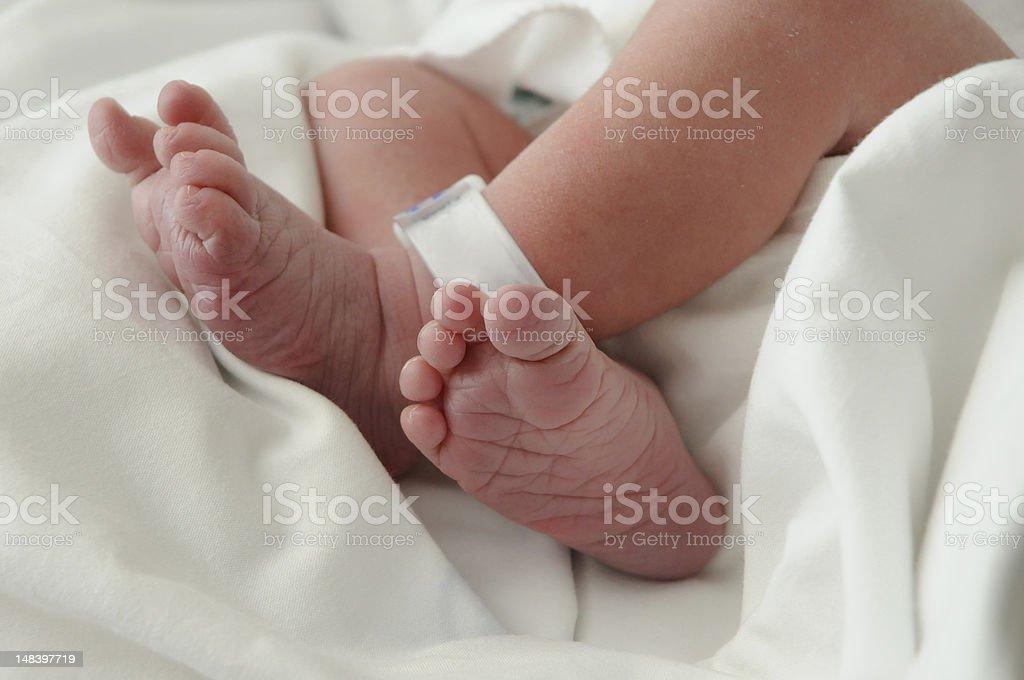 Newborn Crossed Legs stock photo
