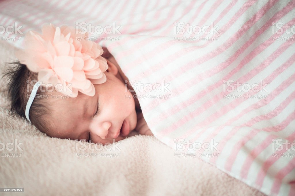 newborn cute girl sleeping on a pink background.Vintage color.soft focus stock photo