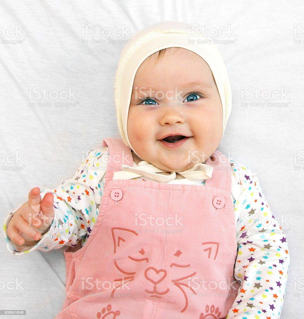 newborn european baby girl boy holding finger 5 months old stock photo