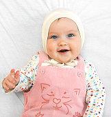 newborn european baby girl boy holding finger 5 months old