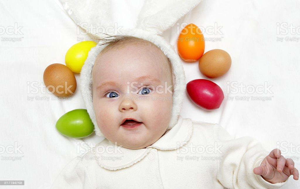 newborn european baby girl boy with easter bunny ears stock photo