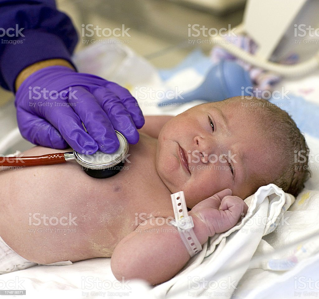 Newborn examination royalty-free stock photo