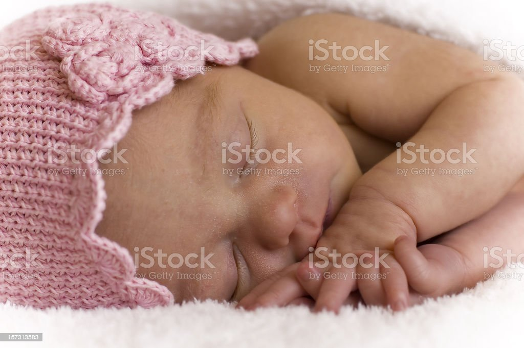 Newborn girl in pink hat royalty-free stock photo