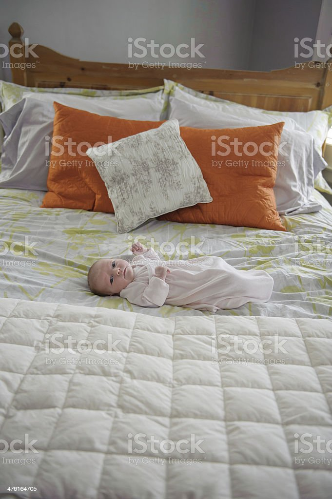 Newborn Girl Laying on Bed royalty-free stock photo