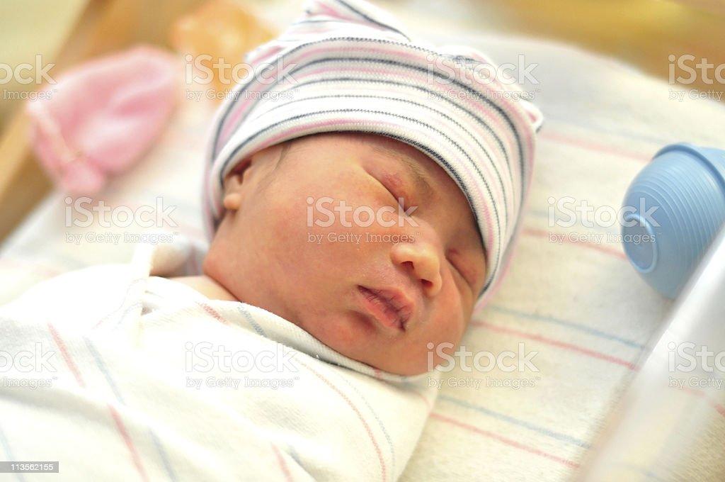 newborn girl sleeping stock photo