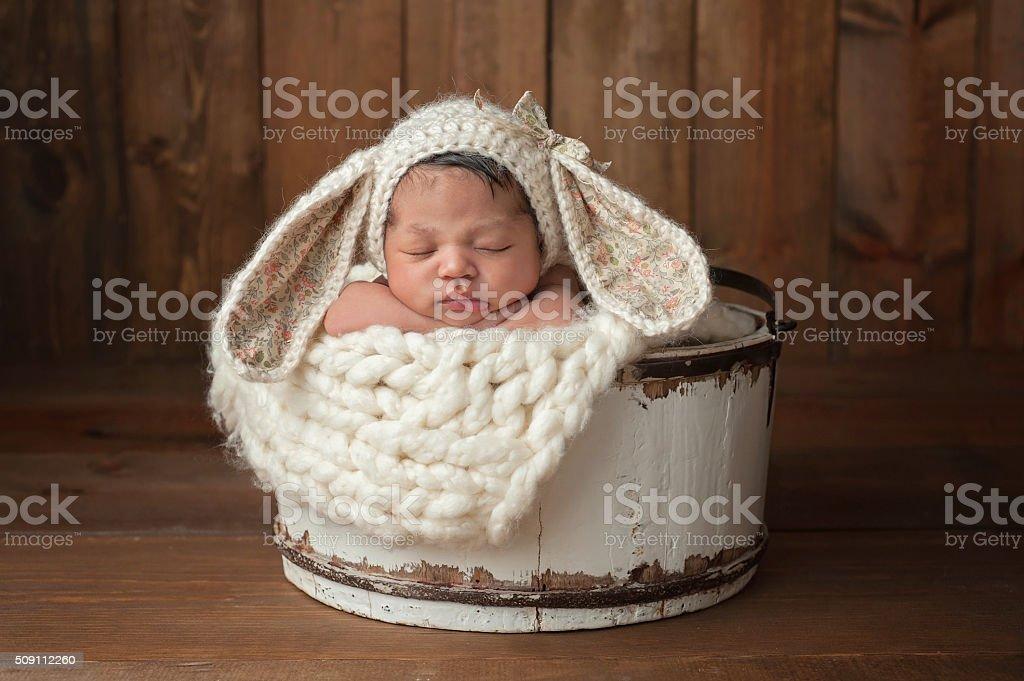 Newborn Girl Wearing a Bunny Bonnet stock photo
